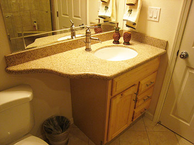 Condo bath with custom granite on a maple vanity
