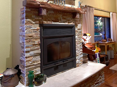 Beautiful Stone Fireplace with 'Ohi'a Mantle