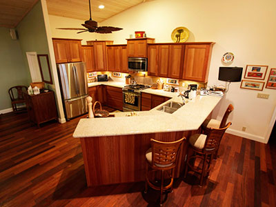 Spacious Kitchen with Merbau Floors and Lyptus Cabinets